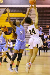George P. Smith/The Montgomery Sentinel    Richard Montgomery's Taheerah Rashad (24) with the layup past Clarksburg's Athina Nana Nkangnia (20).