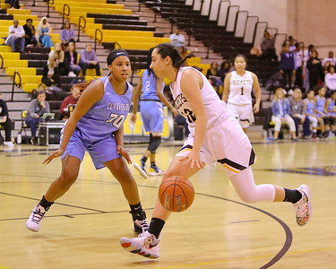 George P. Smith/The Montgomery Sentinel    Richard Montgomery's Talia Kouncar (12) drives past Clarksburg's Kaleah Boykin (30).