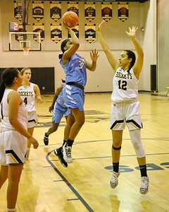 George P. Smith/The Montgomery Sentinel    Clarksburg's Kaleah Boykin (30) with the one-handed jump shot over Richard Montgomery's Talia Kouncar (12).