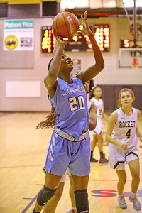 George P. Smith/The Montgomery Sentinel    Clarksburg's Athina Nana Nkangnia (20) slices to the hoop for a layup.
