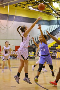 George P. Smith/The Montgomery Sentinel    Richard Montgomery's Mackenzie Caldwell-Degnon (13) makes a three over Clarksburg's Alanna Tate (14).