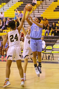 George P. Smith/The Montgomery Sentinel    Clarksburg's Kaleah Boykin (30) with the one-handed jumper over Richard Montgomery's Taheerah Rashad (24).