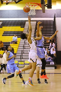 George P. Smith/The Montgomery Sentinel    Richard Montgomery's Taheerah Rashad (24) with the layup past Clarksburg's Anaya Martin (23).
