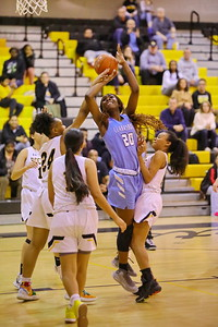 George P. Smith/The Montgomery Sentinel    Clarksburg's Athina Nana Nkangnia (20) gets fouled by Richard Montgomery's Taheera Rashad (24) as she shoots.