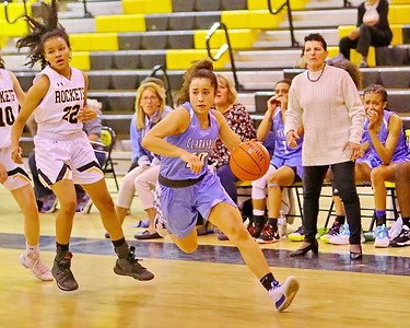 George P. Smith/The Montgomery Sentinel    Clarksburg's Miki Howson (10) drives to the hoop.