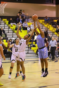 George P. Smith/The Montgomery Sentinel    Clarksburg's Kaleah Boykin (30) pulls down a booming offensive rebound over Richard Montgomery's Taheerah Rashad (24).
