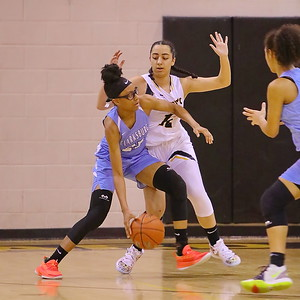 George P. Smith/The Montgomery Sentinel    Clarksburg's Anaya Martin (23) works her way to the basket against Richard Montgomery's Talia Kouncar (12).