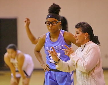 George P. Smith/The Montgomery Sentinel    Clarksburg head coach Sissy Natoli with a couple of pointers for Anaya Martin (23).