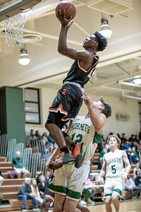 January 17, 2020 -  Aloye Expeso of Rockville leads a fast break in the second half for two of his 24 points in the 60-47 win over Damascus. Photo by Mike Clark/The Montgomery Sentinel