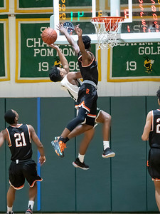 January 17, 2020 - Rockville's Aloye Expeso skies to block the shot attempt by Preston Murray of Damascus. Expreso scored 24 points in the 60-47 win in front of the Damascus home crowd on January 17. Photo by Mike Clark/The Montgomery Sentinel