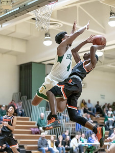 January 17, 2020 - Preston Murray of Damascus swoops in for this dramatic block of Rockville's Aloye Expeso layup attempt in the second half of the  60-47 win over home team Damascus on January 17. Photo by Mike Clark/The Montgomery Sentinel