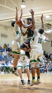 January 17, 2020 - Despite the stout Damascus defense on this play, Aloye Expreso of Rockville found a way to put up two of his 24 points in the 60-47 win over Damascus. Photo by Mike Clark/The Montgomery Sentinel