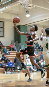 January 17, 2020 - Thomas Hailegebriel of Rockville leads a fast break past Damascus for two of his eight points. Rockville led by 10 points most of the game and finished off home team Damascus 60-47 on January 17. Photo by Mike Clark/The Montgomery Sentinel