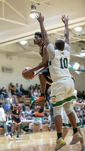January 17, 2020 - Rockville's Aloye Expeso flies past Kynu Stone of Damascus for two of his 24 points in the 60-47 win in front of the Damascus home crowd on January 17. Photo by Mike Clark/The Montgomery Sentinel