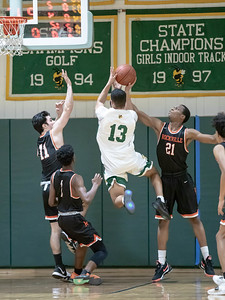 January 17, 2020 - The Rockville Rams' defense denies Chris Shaw of Damascus on this drive and held the Hornets to only 47 in the 60-47 loss at home on January 17. Photo by Mike Clark/The Montgomery Sentinel