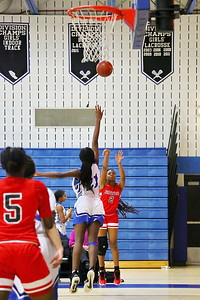 George P. Smith/The Montgomery Sentinel    Northwood's Jordan Sales (2) lauches over Rachel Mutombo (21) from deep in the corner.