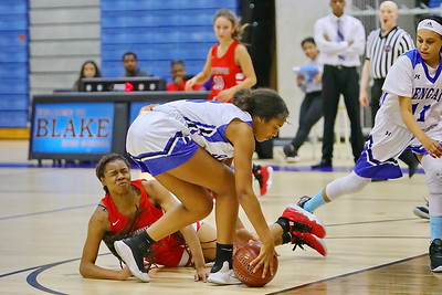George P. Smith/The Montgomery Sentinel    Northwood's grimaces after a collision as Blake's Nadia Wilson (3) picks up the loose ball and heads the other way.