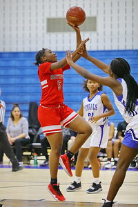 George P. Smith/The Montgomery Sentinel    Northwood's Adiatu Timbo (5) with the runner up the gut.