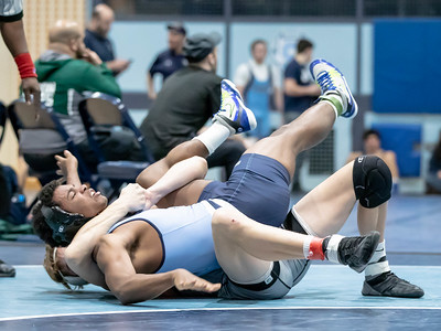 January 18, 2020 - Northwest's John Wallmark takes down Springbrook's Edwin Piralta in a 9-1 decision to take the  160 lb. weight class at the Grapple at the Brook at Springbrook High School on January 19th. Photo by Mike Clark/The Montgomery Sentinel