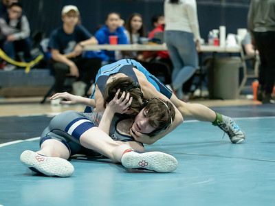 January 18, 2020 - Johnny Pisano of Clarksburg High School celebrates his victory over Jake Williams with a fall at 1:51 in the 106 lb. weight class finals during the Grapple at the Brook at Springbrook High School on January 19th. Photo by Mike Clark/The Montgomery Sentinel