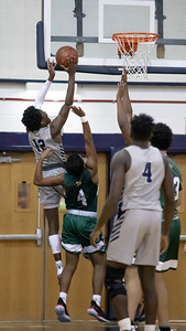 January 3, 2020 - Michael Myrie of Magruder crashes the boards and puts back this shot in the first half of the 95-63 win over Damascus at home on January 3rd. Photo by Mike Clark/The Montgomery Sentinel