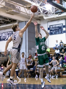 January 3, 2020 - Magruder's Travis Crandall lays in two of his eight points in the 95-63 win over visiting Damascus. Photo by Mike Clark/The Montgomery Sentinel