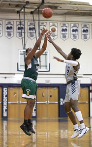 January 3, 2020 - Kyun Stone led Damascus scores with 21 points, including this three-pointer, one of his three, against Magruder. Damascus could not close the gap though and lost to host Magruder 95-63. Photo by Mike Clark/The Montgomery Sentinel