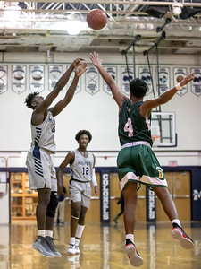 January 3, 2020 - Magruder's Chris Asamoah drains one of his six three-pointers in the dominating 95-63 win over Damascus at home on January 3rd. Photo by Mike Clark/The Montgomery Sentinel