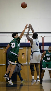 January 3, 2020, Magruder's Chris Asamoah gets off a three pointer over Damascus' Jackson Thomas. Asamoah propelled the Colonials to a 95-63 win with six three-oiunters and 23 total points. Photo by Mike Clark/The Montgomery Sentinel