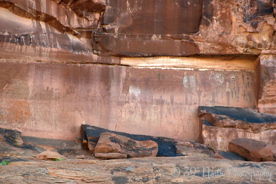 Courthouse Wash Pictograph Panel. The site, located in Arches National Park, was heavily vandalized in 1980, but conservation work has helped preserve and stabilize the site.   You will see large painted ghost-like illustrations typical of the Barrier Canyon Style Archaic figures on the red-orange surface. The numerous figures include human forms, bighorn sheep, shields, scorpion-like illustrations, possible dogs, a long-beaked bird and abstract elements. You can see evidence of painted multi-colored figures superimposed on other pictographs. On the desert varnish surface you will see human and animal-like figures as well as abstract forms. This site is on the National Register of Historic Places because of its representation of a Barrier Canyon Style rock art panel.  Here's what part of the panel looked like before it was vandalized: http://www.nps.gov/arch/historyculture/images/Moab-Panel-bigger.jpg