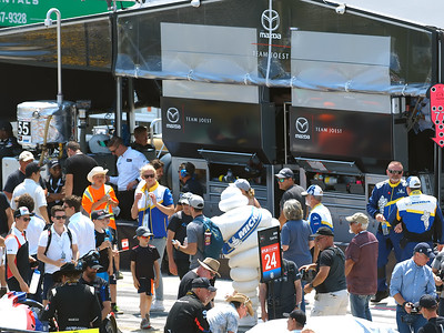 Fan pit lane walk in front of the Mazda pit area.