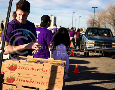 Cody Holthoas, junior in Business Management and Human Resources, oversees the boxes of strawberries at the Mobile Food Pantry sponsored by HandsOn K-State on Feb. 10. The Mobile Food Pantry is aimed at providing food securtiy for Riley County and K-State affliated residents. (Alanud Alanazi | The Collegian)