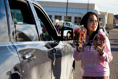 Sarocha Pradyawong, PhD Graduate in Biological and Agriculture Engineering, holds up two boxes of strawberries to distribute at the Mobile Food Pantry sponsored by HandsOn K-State on Feb. 10. The Mobile Food Pantry is aimed at providing food securtiy for Riley County and K-State affliated residents. (Alanud Alanazi | The Collegian)