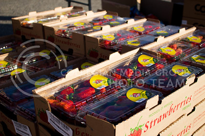 A stack of strawberry boxes o distribute at the Mobile Food Pantry sponsored by HandsOn K-State on Feb. 10. The Mobile Food Pantry is aimed at providing food securtiy for Riley County and K-State affliated residents, where residents can drive up to an open line of foods. (Alanud Alanazi | The Collegian)