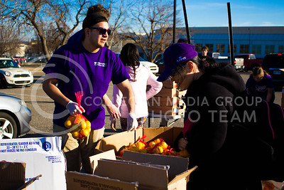 Dominique Hoover, senior in Mechanical Engineering, picks up lemons to distribute at the Mobile Food Pantry sponsored by HandsOn K-State on Feb. 10. The Mobile Food Pantry is aimed at providing food securtiy for Riley County and K-State affliated residents. (Alanud Alanazi | The Collegian)