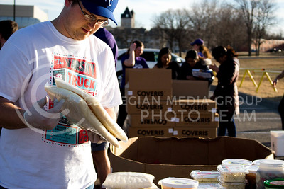 Kaden Littrell, junior in Marketing, oversees the diary produce at the Mobile Food Pantry sponsored by HandsOn K-State on Feb. 10. The Mobile Food Pantry is aimed at providing food securtiy for Riley County and K-State affliated residents, where residents can drive up to an open line of foods. (Alanud Alanazi | The Collegian)
