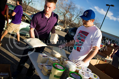 Nathan Shmidt, freshman in Finance, and Kaden Littrell, junior in Marketing, oversee the diary products to distribute at the Mobile Food Pantry sponsored by HandsOn K-State on Feb. 10. The Mobile Food Pantry is aimed at providing food securtiy for Riley County and K-State affliated residents. (Alanud Alanazi | The Collegian)