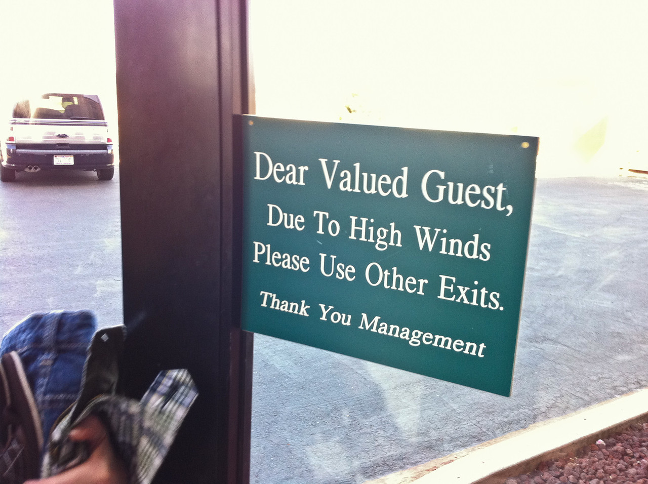 "Sign on the exit door at our hotel in Tucumcari, NM: ""Dear Valued Customer, Due to High Winds Please Use Other Exits. Thank You Management"""
