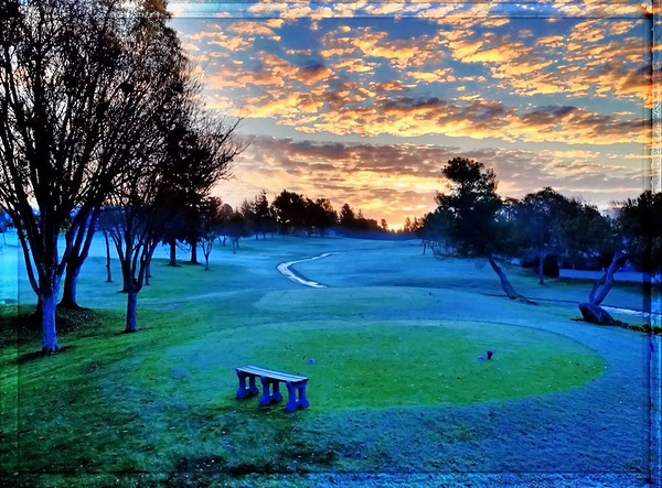 Last night when I checked the weather I saw it was going to be frosty this morning. So I set my alarm and got up at seven. After a cup of coffee I went out to my backyard and caught the sunrise while the golf course was still all frosty.