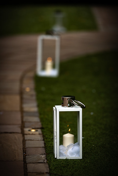 Pretty lanterns light the way to the lakeside gazebo