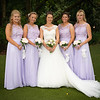 Bride and bridesmaids in the lovely setting of Moddershall Oaks