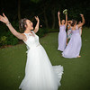 Celebrating catching the bride's bouquet