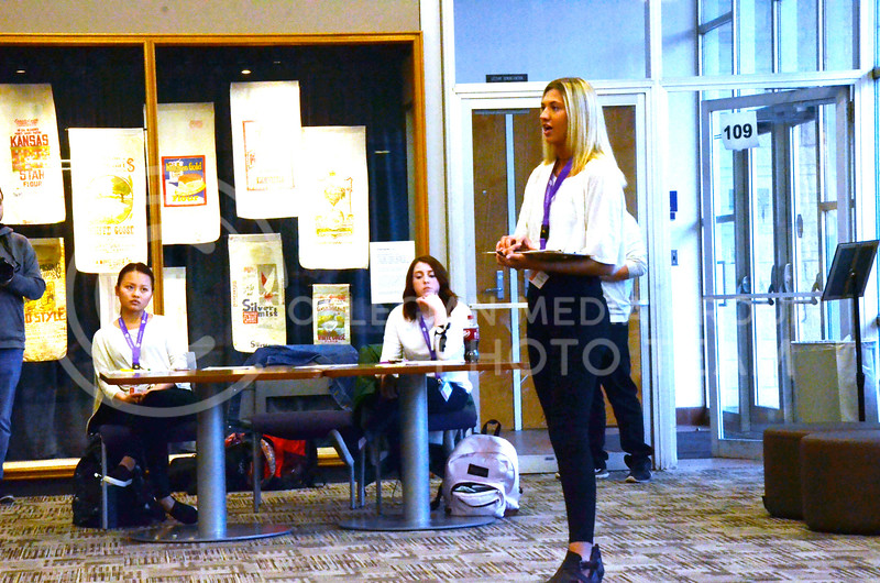 Abby Pfannenstiel, sophomore in apparel and textiles, who has plenty of modeling experience, as evidenced by her Instagram account, @heypfanny, welcomes volunteers at the model casting for the Apparel Textiles and Interior Design Symposium. The casting was held on the evening of Thursday, March 1, 2018, in Justin Hall. (Tiffany Roney | Collegian Media Group)