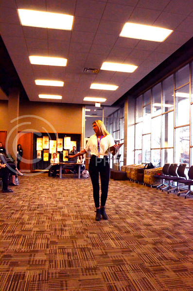 Abby Pfannenstiel, sophomore in apparel and textiles, who has plenty of modeling experience, as evidenced by her Instagram account, @heypfanny, demonstrates a runway walk at the model casting for the Apparel Textiles and Interior Design Symposium. The casting was held on the evening of Thursday, March 1, 2018, in Justin Hall. (Tiffany Roney | Collegian Media Group)