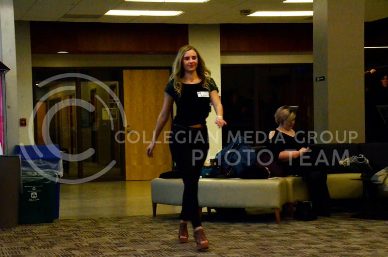 A K-State student shows off her runway walk at a model casting for the Apparel Textiles and Interior Design Symposium on the evening of Thursday, March 1, 2018, at Justin Hall. (Tiffany Roney | Collegian Media Group)