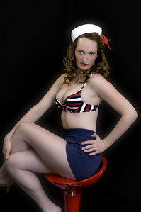 sailor on a red stool