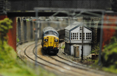 Railex 2012 Mini MSW remember this is in 2mm! a Class 37 passes the signal box