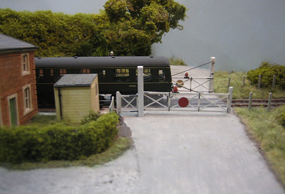 Expo EM 2007 East Lodge, one of the best East Anglian Model railways I have seen, here we see a Class 105 passing over the level crossing.
