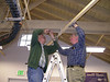 John Green (left) and Ed Leska join two 2x2-inch rods to complete the longest supporting section, in the southeast corner of the Visitor Center, 6/10/2008.