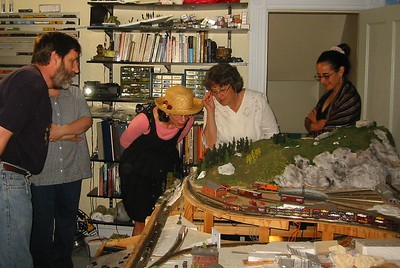 Ken shows his model trains to Stephanie, Olivia, and Madeleine (during HCHL party June 12, 2004)
